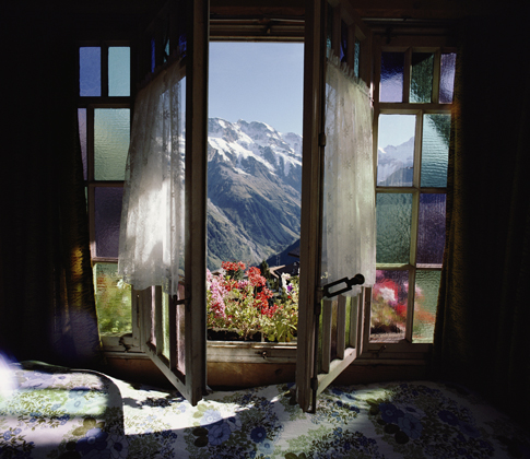 Large windows open to a view of the Bernese Alps.